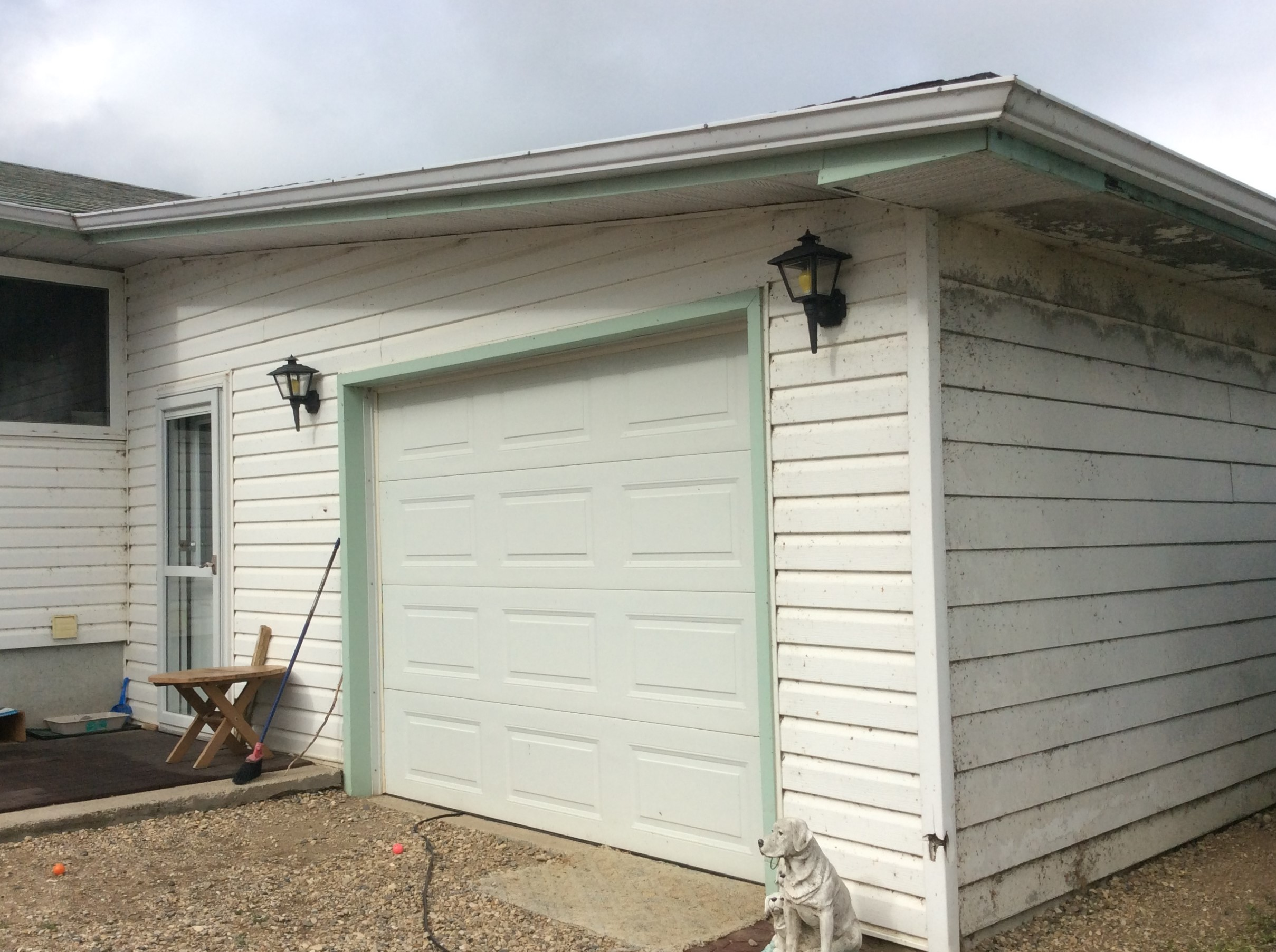 Exterior renovation on a house with hail damage. - Image 1