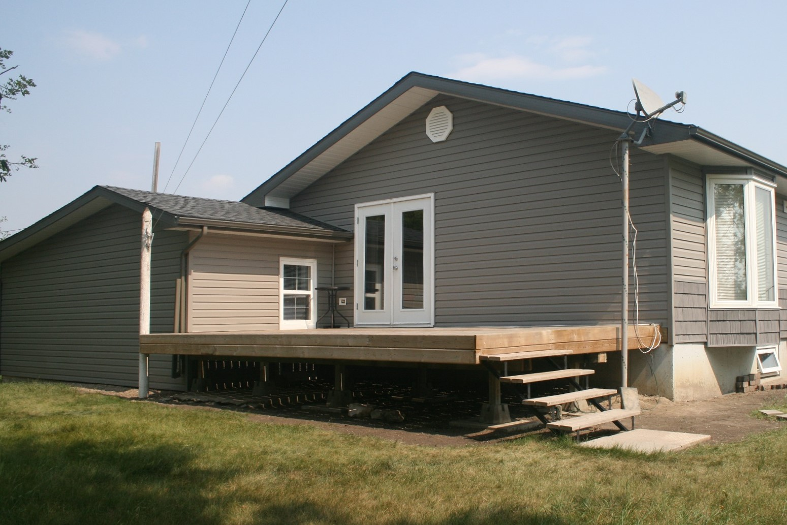 Exterior renovation on a house with hail damage. - Image 10