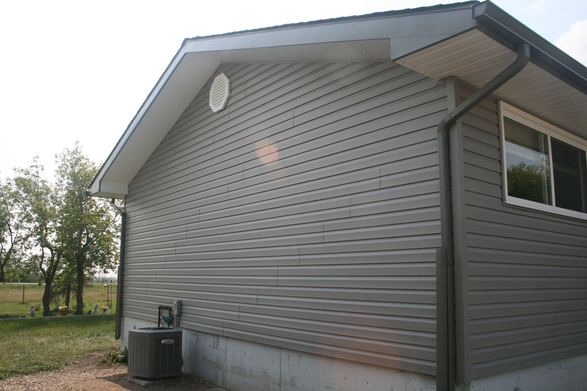 Exterior renovation on a house with hail damage. - Image 13