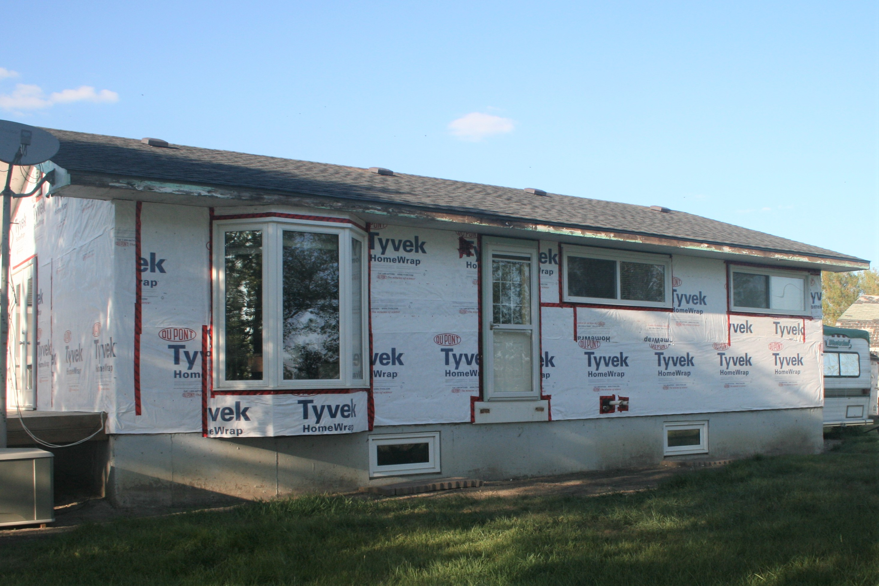 Exterior renovation on a house with hail damage. - Image 6
