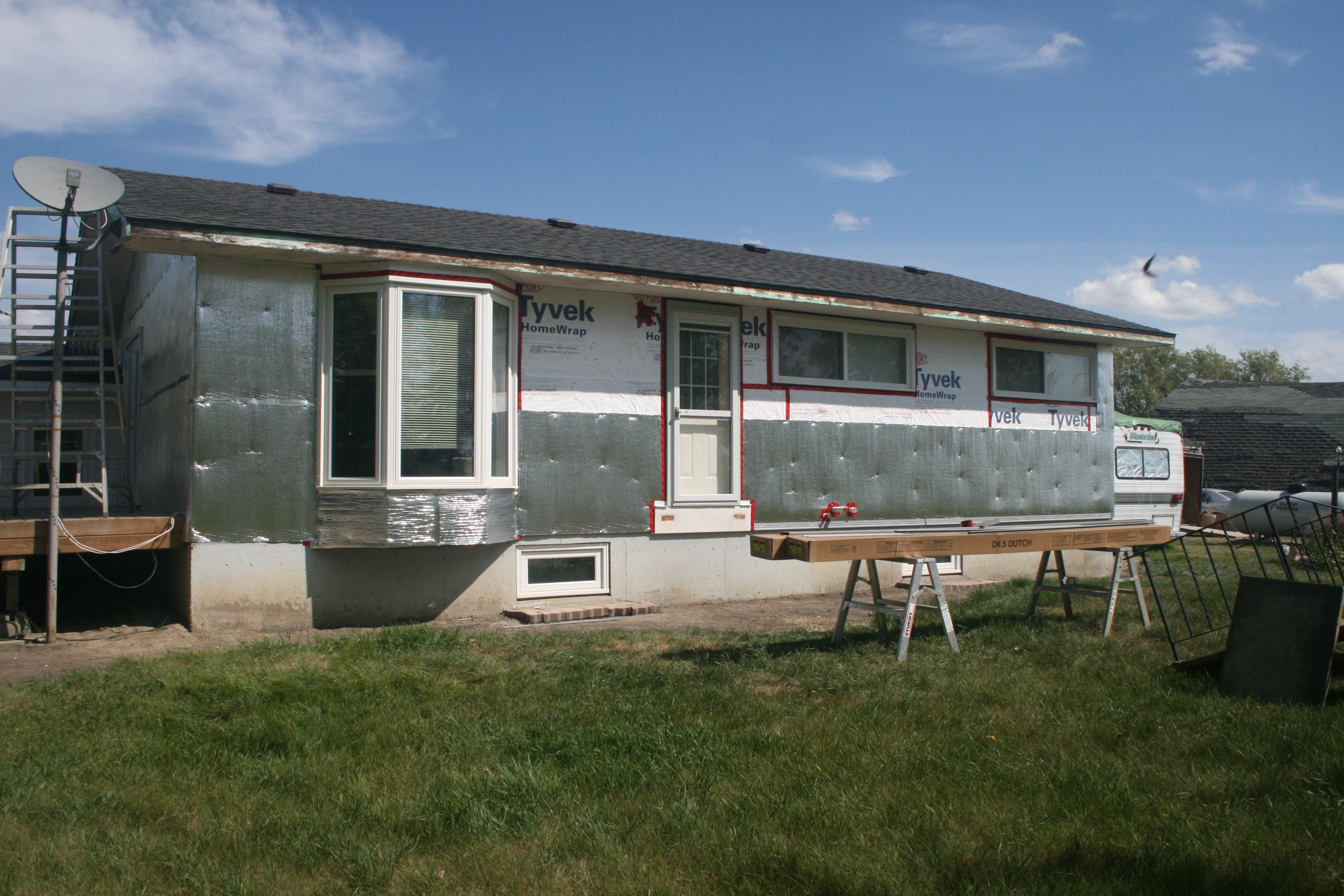 Exterior renovation on a house with hail damage. - Image 7