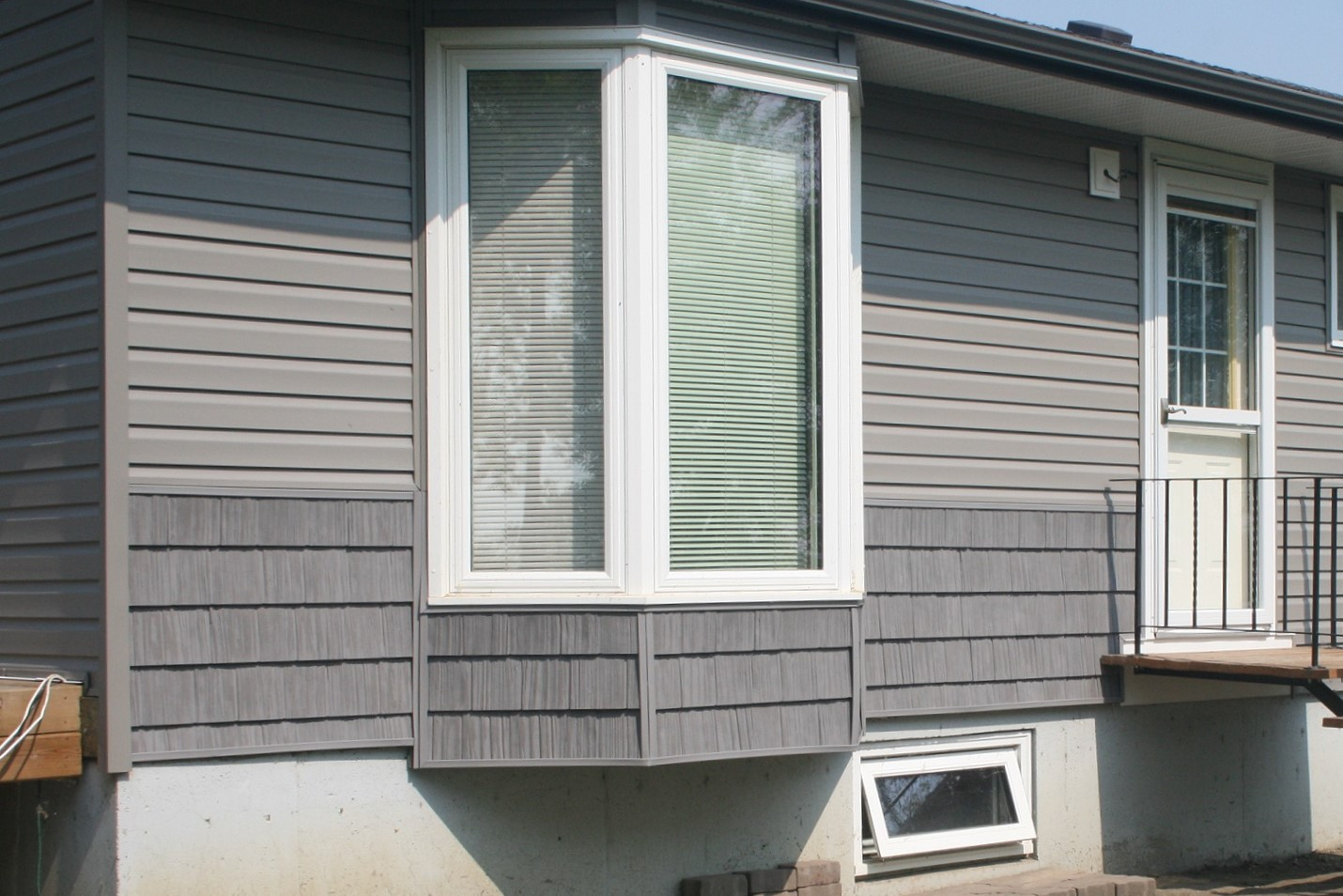 Exterior renovation on a house with hail damage. - Image 8