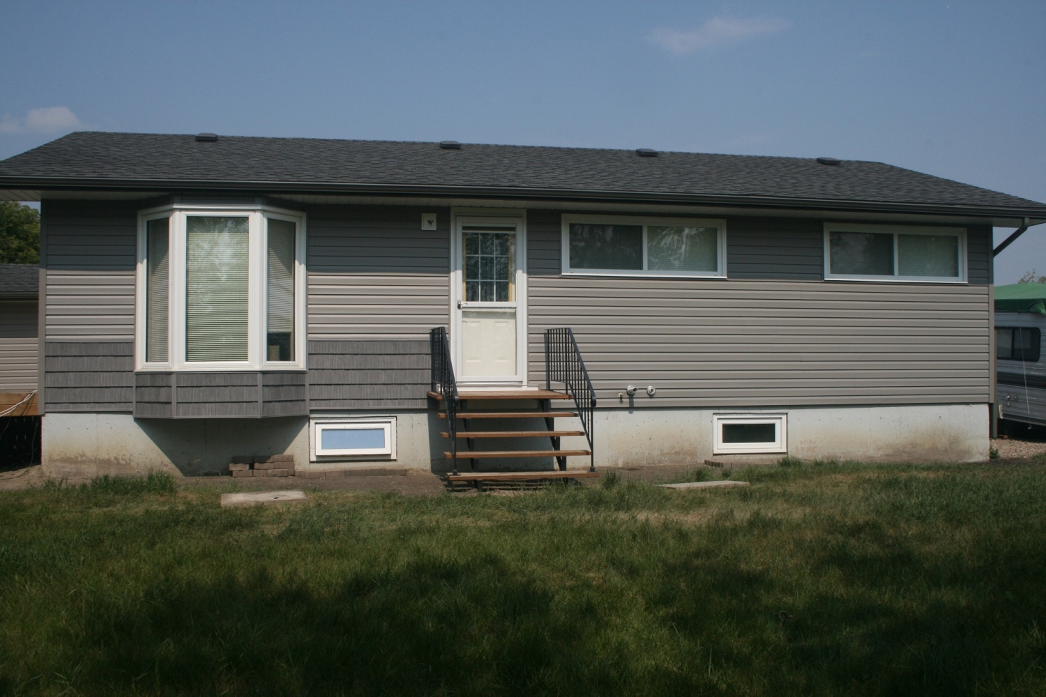 Exterior renovation on a house with hail damage.